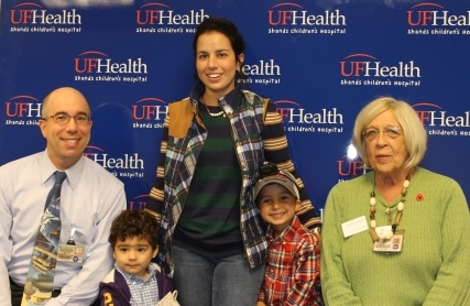 Katrina Gomez with her two sons (Wyatt is on the left) poses for a photo with Dr. Weiss and Judy Angley during the check presentation on Nov. 10.